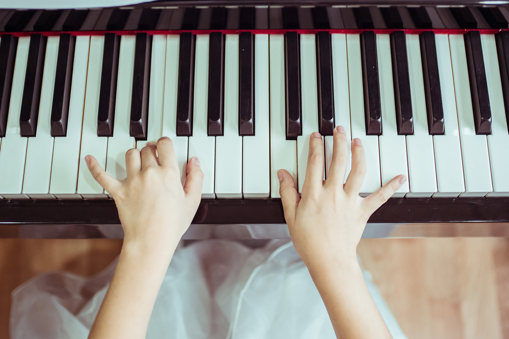 A young girl playing piano.
