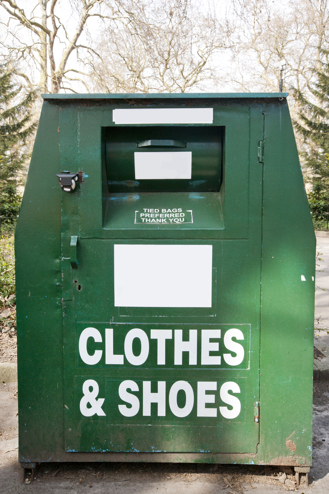 A photo of a donation bin for clothing and shoes.