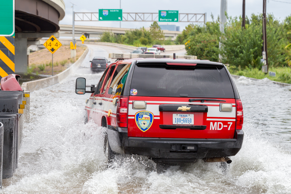 An emergency vehicle in Houston, Texas submerged in water.