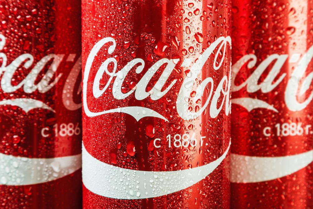 Three Coca-Cola cans.