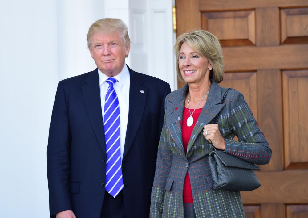 U.S. Secretary of Education Betsy Devos pictured alongside President Trump.