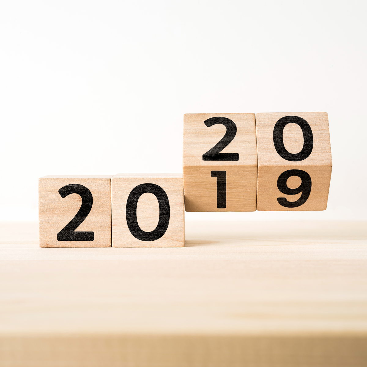 Wooden blocks that are labeled 2019 being changed to 2020.