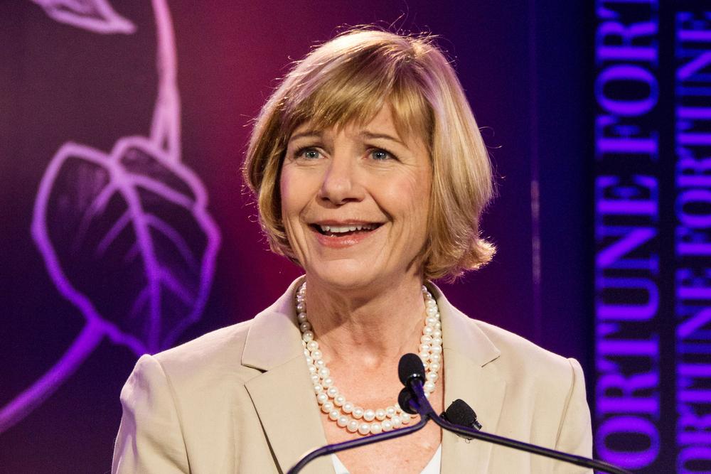 A photo of Sue Desmond-Hellmann giving a speech at the 2012 Most Powerful Women Summit.